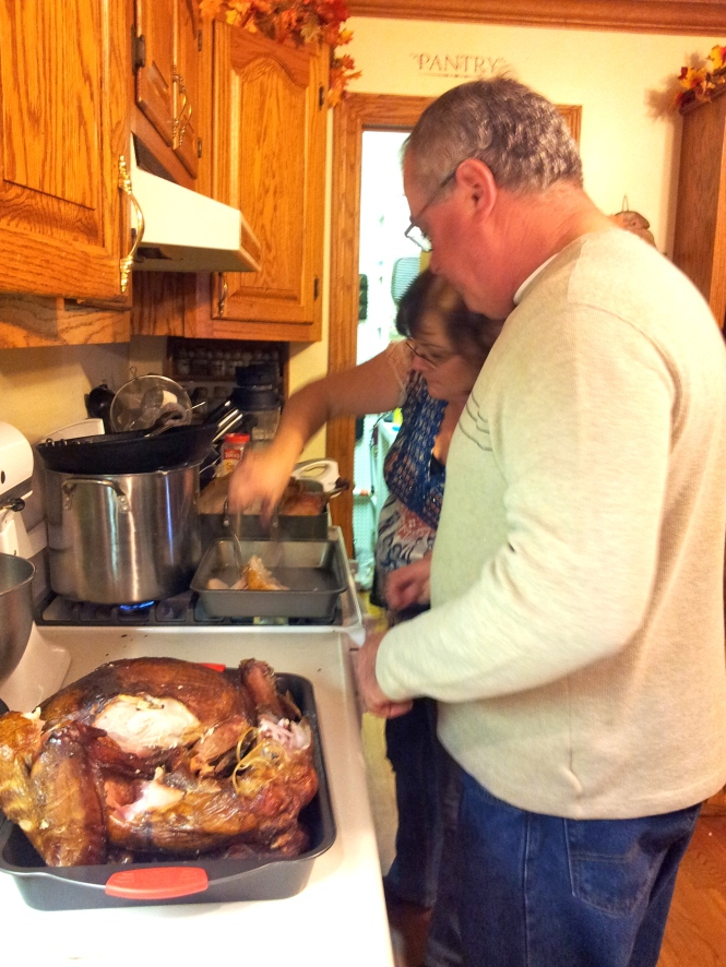 Teamwork! Mom and Herman getting the birds ready to feed the masses.