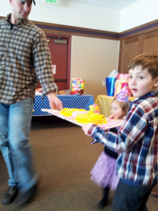 This was almost disastrous.  Noel had a little more help than expected carrying the cake.